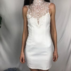 Solemio white body con lace open back mini dress
